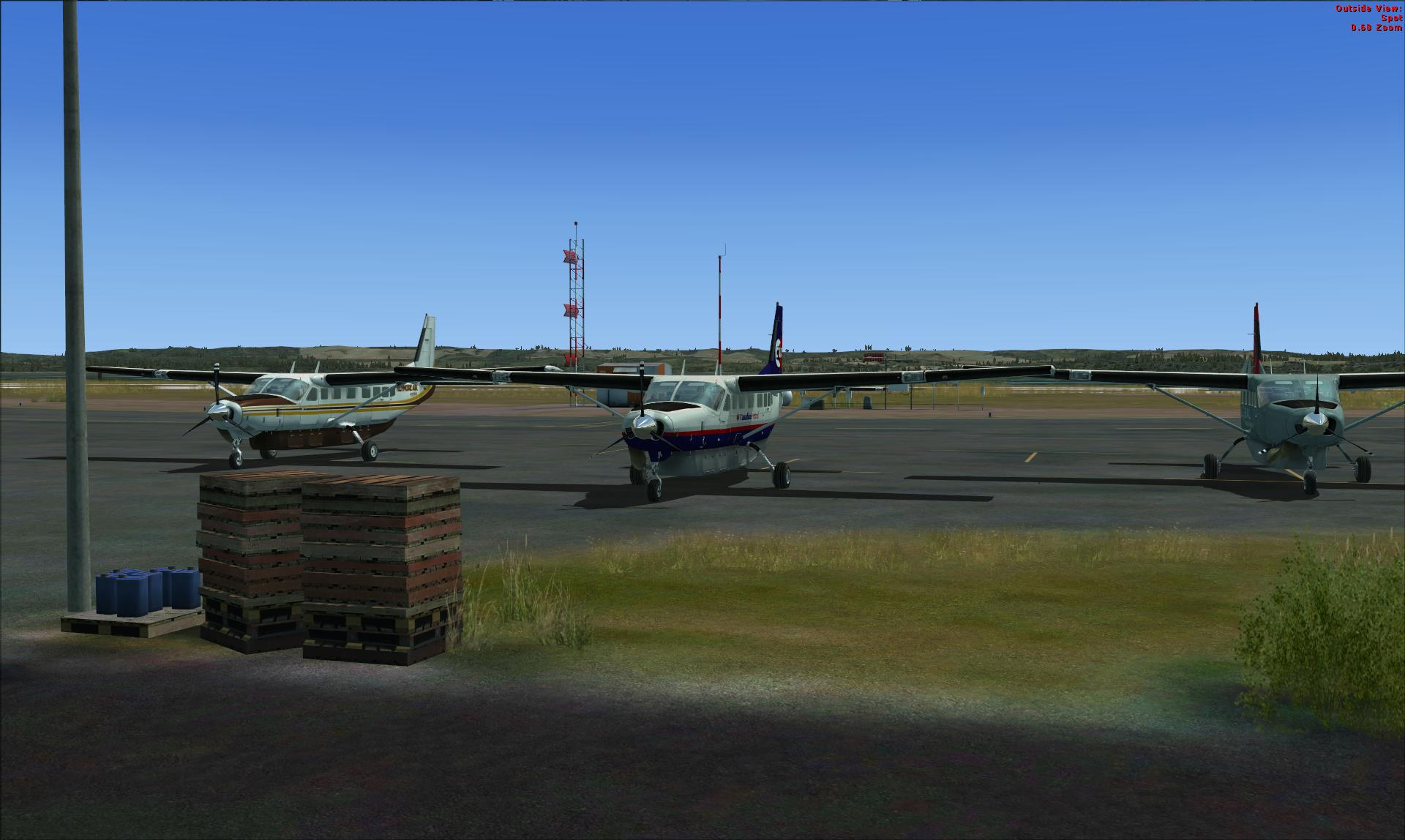 Three Cessna Grand Caravans (look to center for CVA bird) at Orbx's Bowerman Airport (KHQM) CVA flight #6119